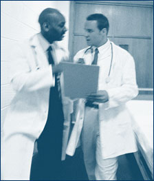 Two doctors discussing a chart